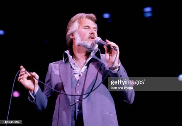 American country singer Kenny Rogers sings on stage during a concert on November 8 1981 at the Crisler Arena in Ann Arbor Michigan