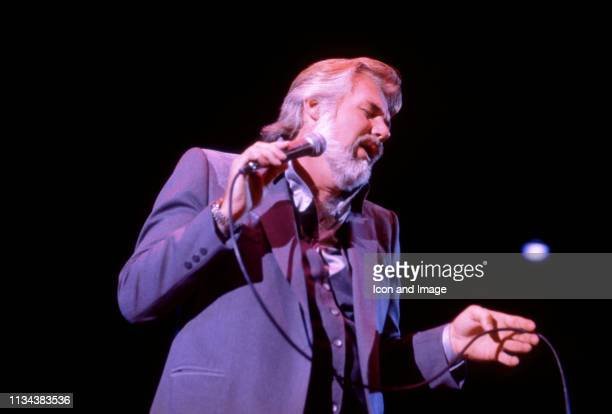 American, country singer Kenny Rogers sings on stage during a concert on November 8, 1981 at the Crisler Arena in Ann Arbor, Michigan.