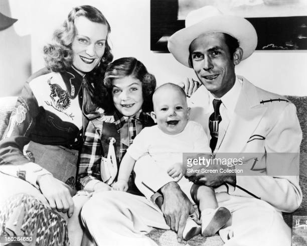 American country singer-songwriter Hank Williams with his family, in Nashville Tennessee, 1949. Left to right: musician Audrey Williams , her...