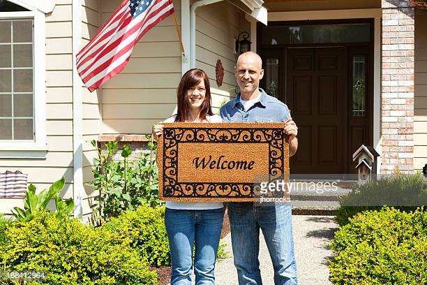 American Couple at Home with Welcome Mat