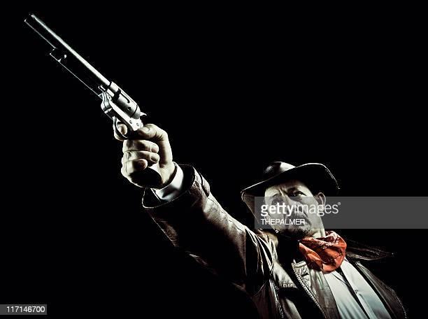 american cowboy aiming a revolver