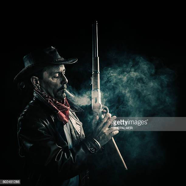 american cowboy smoking - sheriff stock pictures, royalty-free photos & images