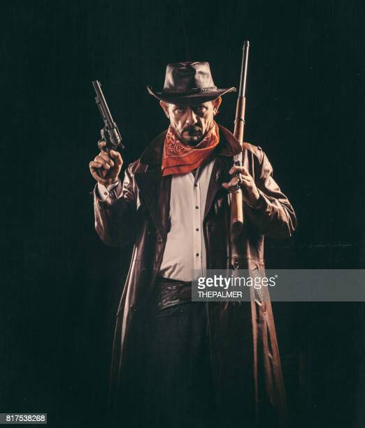 american cowboy with guns - cowboy stock photos and pictures