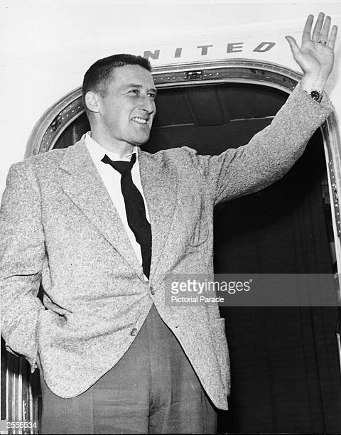 American crime writer Mickey Spillane Frank Morrison Spillane waves from the door of an airplane upon arrival at the airport Los Angeles California...