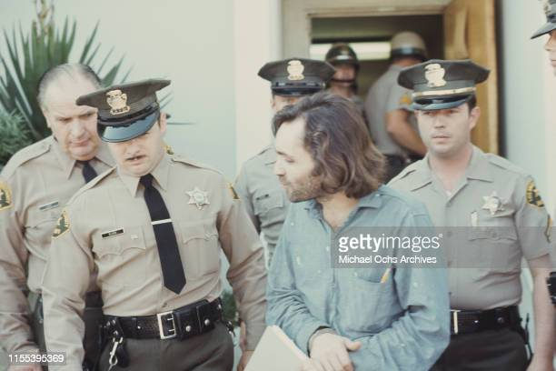 American criminal and cult leader Charles Manson is escorted by Los Angeles County sheriffs to a police van to the Santa Monica Courthouse to appear...