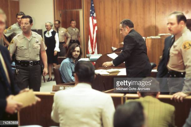 American criminal and cult leader Charles Manson sits at the defendant's table at the Santa Monica Courthouse for a hearing regarding the murder of...