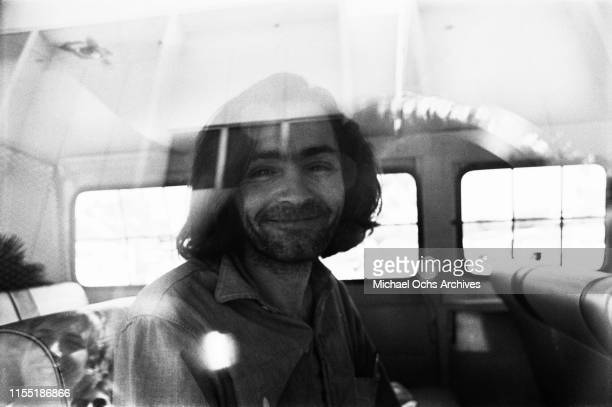 American criminal and cult leader Charles Manson traveling on a police van to the Santa Monica Courthouse to appear in court for a hearing regarding...