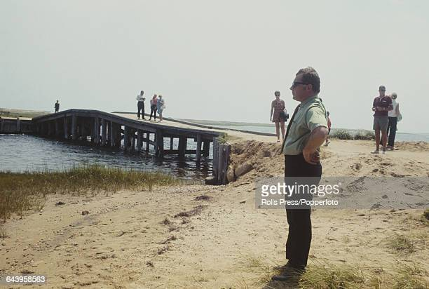 American criminal lawyer F Lee Bailey surveys the scene in front of Dike Bridge on Chappaquiddick Island near Edgartown Massachusetts on 9th August...