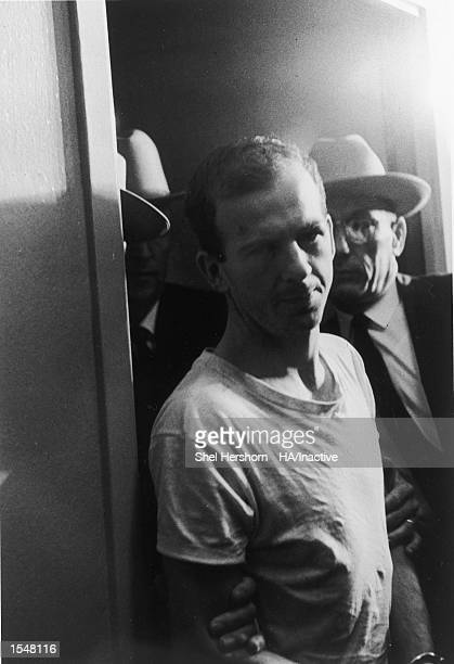 American criminal Lee Harvey Oswald is escorted in handcuffs by Dallas police for questioning following the assassination of president John F....