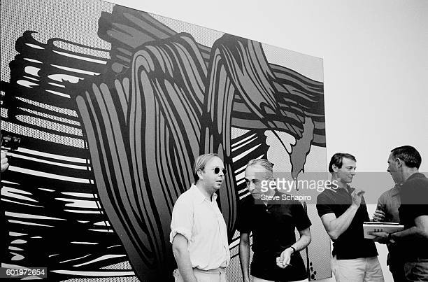 American curator and historian Henry Geldzahler speaks with art dealer and gallery owner Leo Castelli at the Venice Biennale Venice Italy 1966 In the...