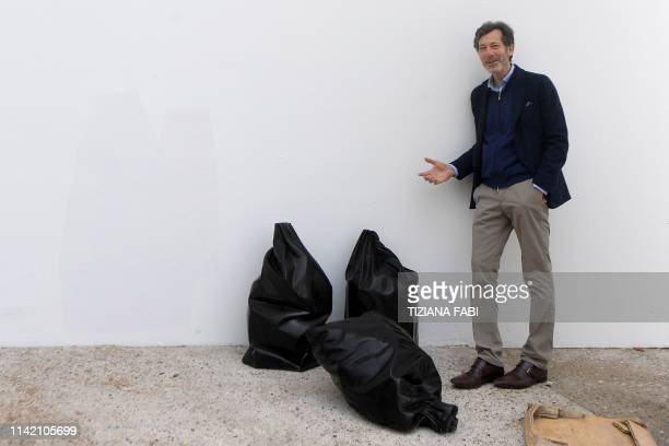 American curator Ralph Rugoff curator of the 58th International Art Exhibition of the Venice Biennale poses on May 7 2019 in Venice The 58th...