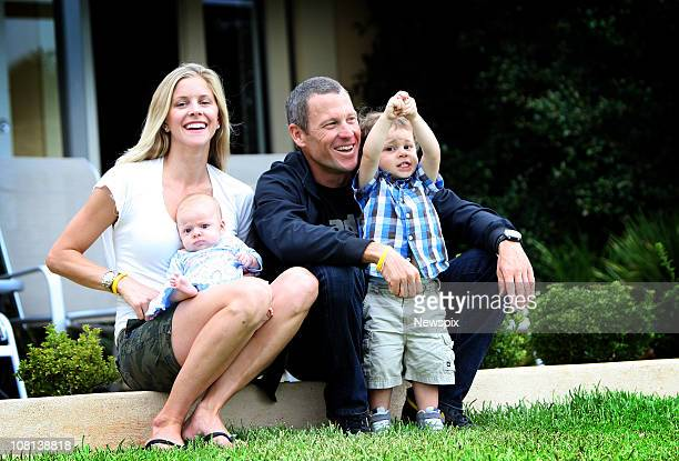 American cyclist Lance Armstrong sits with his partner Anna Hansen and their two children Olivia Armstrong and Max Armstrong January 13 2011 in the...