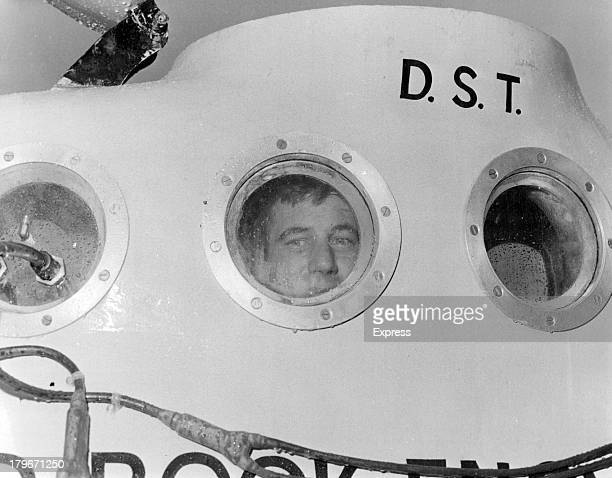 American Dan Taylor checks one of the observation ports in his yellow 20foot submarine just one of the innumerable routines that go with searching...