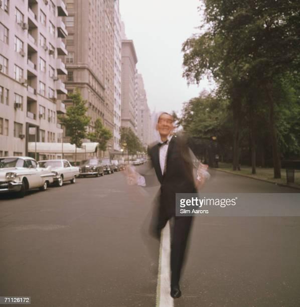 American dance instructor 'Killer' Joe Piro dances past the park in New York July 1964
