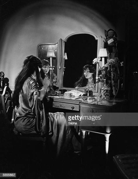 American dancer Adele Astaire dancing partner and sister of Fred Astaire sitting at a dressing table in a silk dressing gown