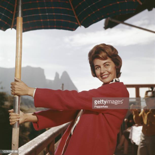 American dancer and actress Cyd Charisse pictured at a cafe in the South Tyrol mountains during a break in shooting the film 'Five Golden Hours' on...