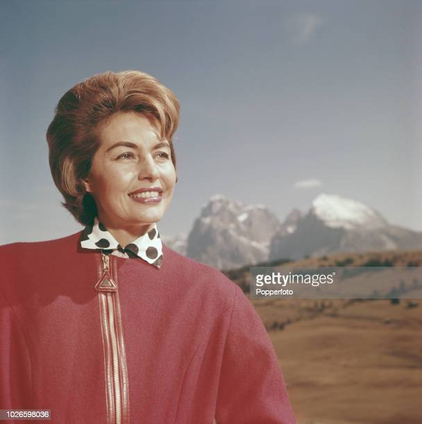 American dancer and actress Cyd Charisse pictured in the South Tyrol mountains during a break in shooting the film 'Five Golden Hours' on location...