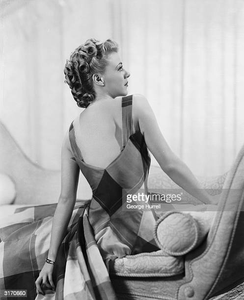 American dancer and actress Ginger Rogers wearing a patterned summer dress with shoulder straps.