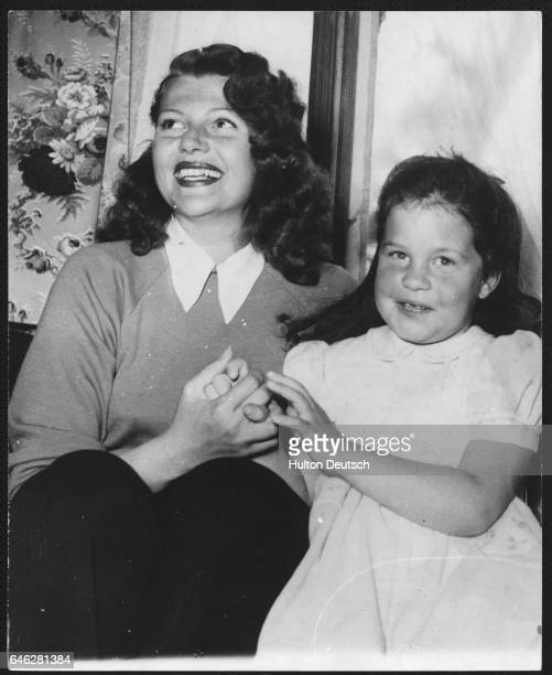 American dancer and actress Rita Hayworth holidaying with her daughter Rebecca in Gstaad Switzerland 1950 Rebecca is the daughter of Orson Welles