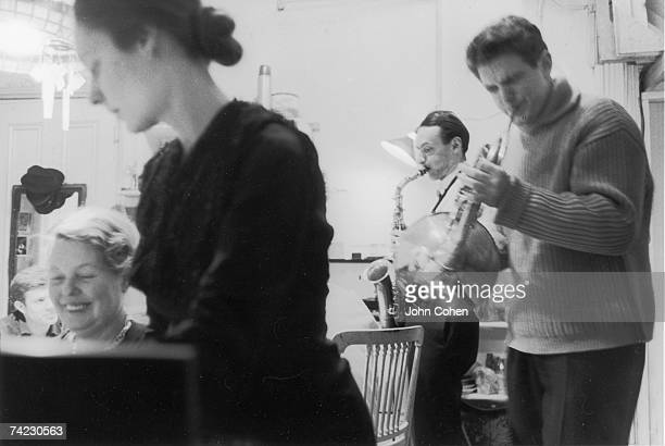 American dancer and choreographer Sally Gross at the piano with American artist Alice Neel while American artist Larry Rivers plays the saxophone and...
