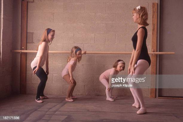 American dancer and dance instructor and future actress Goldie Hawn demonstrates a position for her young ballet students Washington DC 1964