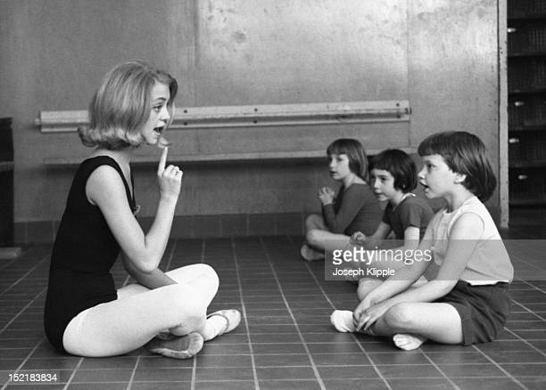 American dancer and dance instructor and future actress Goldie Hawn sits on the floor to speak with her young dance students Washington DC May 6 1964