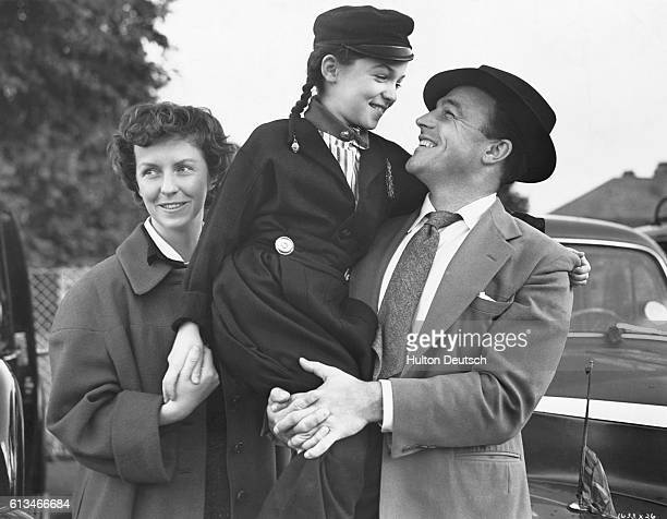 American dancer and film actor Gene Kelly visiting London with his wife actress Betsy Blair and daughter Kerry 1955