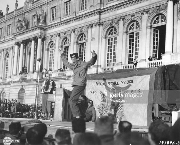 American dancer and film star Fred Astaire , performs onstage for American soldiers at Versailles, during a USO show for the troops, France,...