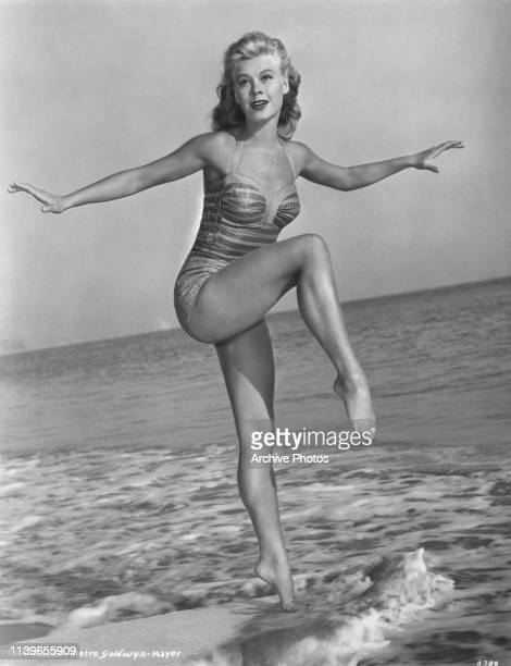 American dancer and MGM actress VeraEllen wearing a onepiece swimsuit on the beach circa 1950