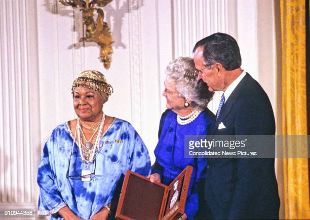 American dancer choreographer and activist Katherine Dunham is awarded the National Medal of Arts by US First Lady Barbara Bush and President George...