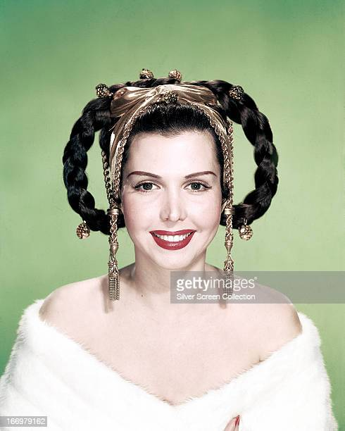 American dancer singer and actress Ann Miller modeling a braided hairstyle decorated with a gold headdress circa 1945
