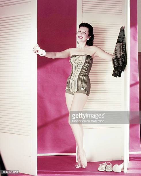 American dancer singer and actress Ann Miller posing in a onepiece swimsuit circa 1945