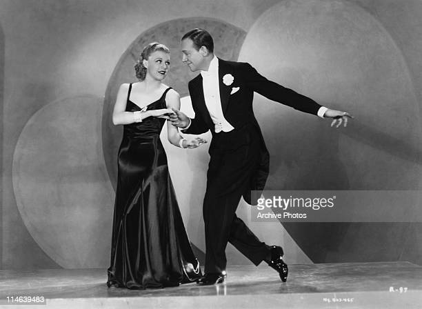 American dancers singers and actors Ginger Rogers and Fred Astaire dancing in a scene from 'Roberta' directed by William A Seiter 1935