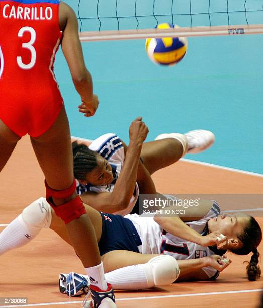 American Danielle Scott returns the ball while her teammate Robyn Ah Mow-Santos looks on during the World Cup women's volleyball tournament against...
