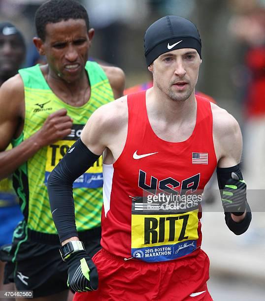American Dathan Ritzenhein works in Mile 13 in front of Yemane Adhane Tsegay of Ethiopia The 119th Boston Marathon is run on Monday April 20 2015