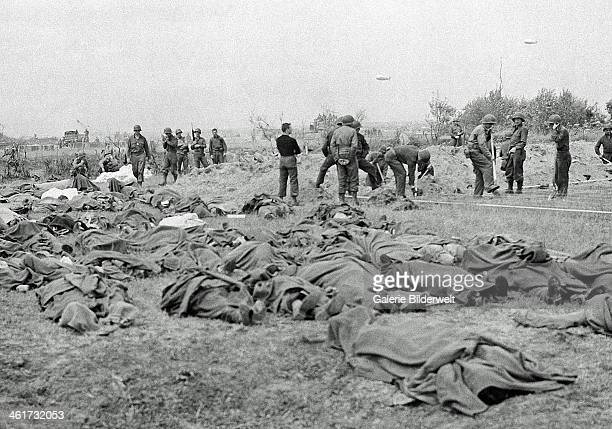 American dead lie in a French field a short distance from the allied beachhead 20th June 1944 Normandy France