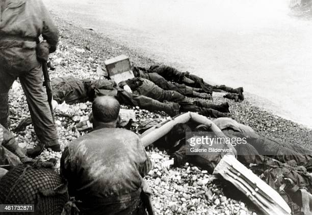American dead soldiers from the 3rd Battalion 16th Infantry Regiment 1st Infantry Division on a pebble beach 6th June1944 Photo Taylor Omaha Beach...