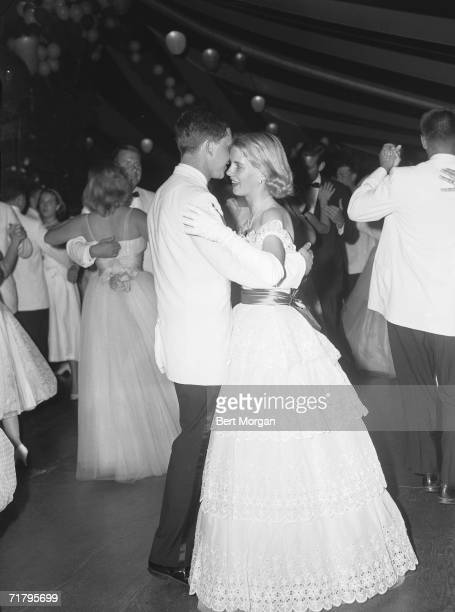 American debutante Lynn Willing Wanamaker dances with a young man at a dinner dance in honor of Susan Bixby Andrews and Wanamaker at the home of Mr...