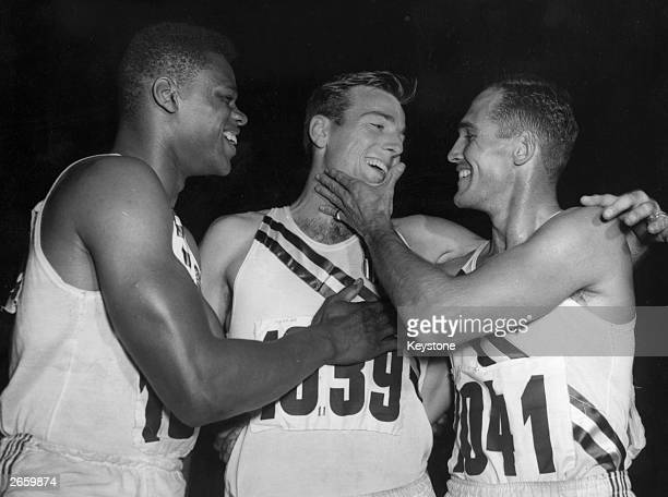 American Decathlon medal winners Milton Campbell Bob Mathias and Floyd Simmons in a happy mood at the Olympic Games in Helsinki Finland