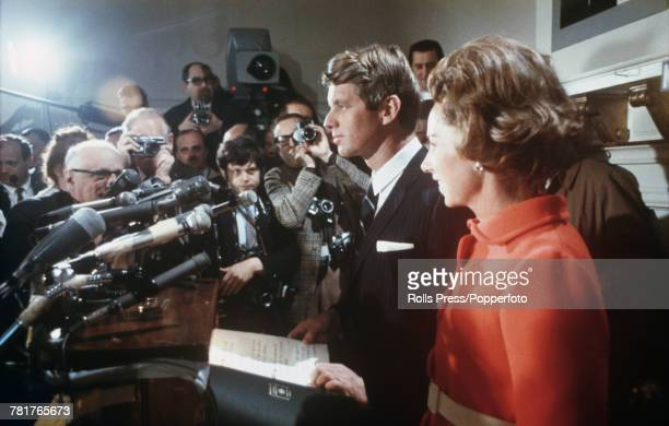 American Democratic Party politician and Senator from New York Robert F Kennedy pictured standing beside his wife Ethel Kennedy at a press conference...