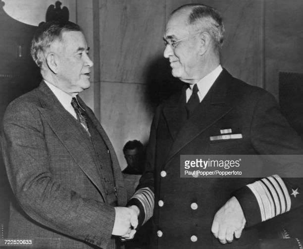 American Democratic Party politician and United States Senator from Kentucky Alben W Barkley shakes hands with Admiral James O Richardson during the...