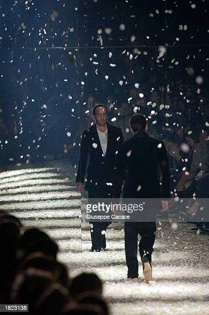 American designer Tom Ford reflected in a mirror walks down the runway after the Gucci Autumn/Winter 2003-2004 collection fashion show March 1, 2003...