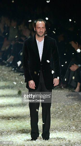 American designer Tom Ford walks down the runway after the Gucci Autumn/Winter 2003-2004 collection fashion show March 1, 2003 in Milan, Italy.