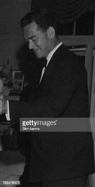 American diplomat and publisher John Hay 'Jock' Whitney dancing at Sarah Rosevelt's going away party at Greentree his home in Manhasset Long Island...