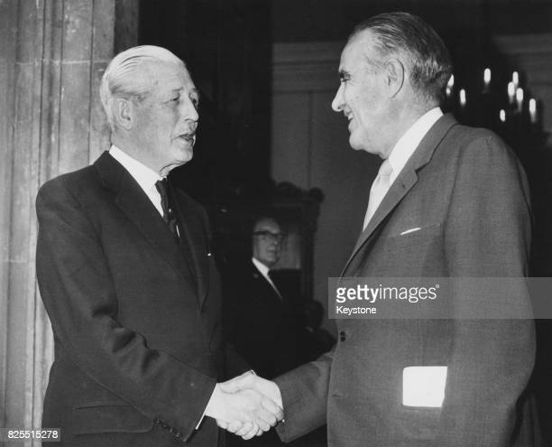 American diplomat W Averell Harriman the US UnderSecretary of State shakes hands with British Prime Minister Harold Macmillan after lunch at...