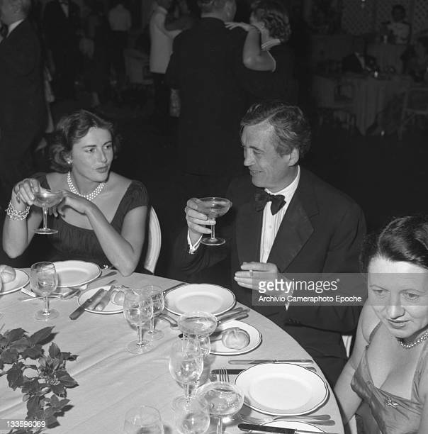 American director and actor John Huston during a dinner party sitting at the table Venice 1953