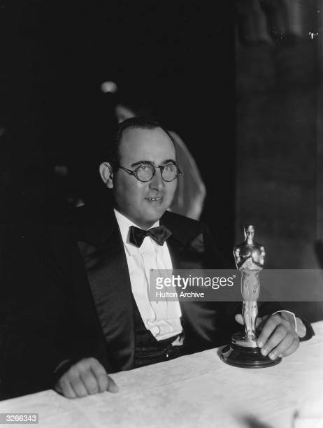American director and former child actor Norman Taurog at the Academy Awards with the gold statuette or Oscar he has just received for Best Director...
