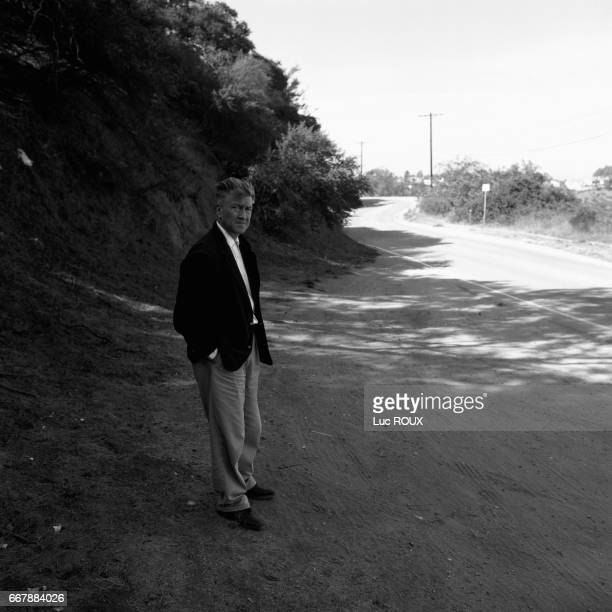 American director and screenwriter David Lynch on the set of his movie Mulholland Dr Here he stands along the famous Mulholland Road