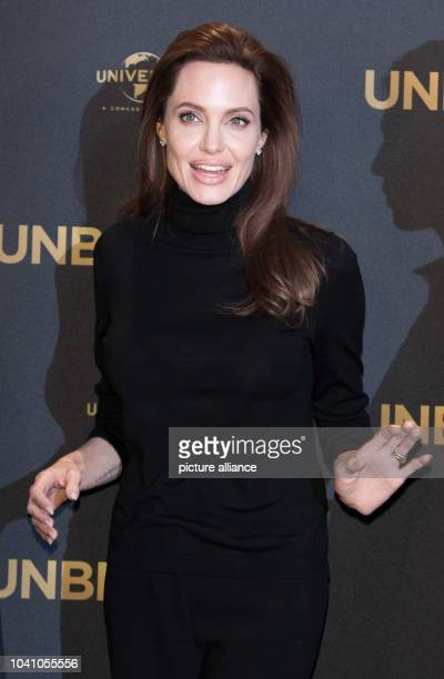 American director Angelina Jolie attends the photocall on occasion of her movie presentation 'Unbroken' in Berlin, Germany, 27 November 2014. The...
