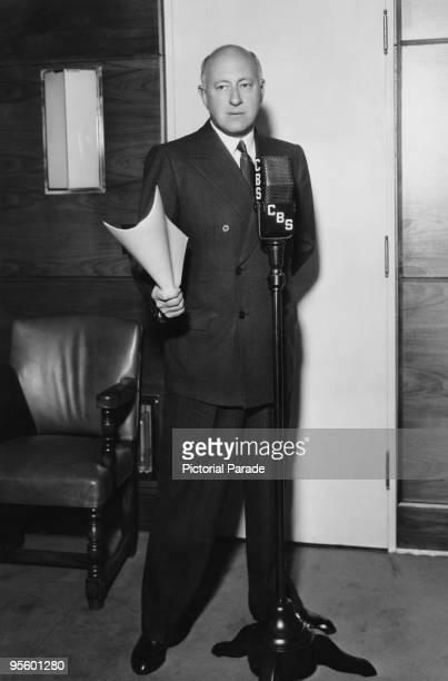 American director Cecil B DeMille at the microphone in a CBS radio studio circa 1935